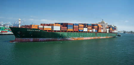 san pedro: San Pedro, CaliforniaUSA June 2015.  Container ship Agusta Kontor transporting cargo at The Port of Los Angeles
