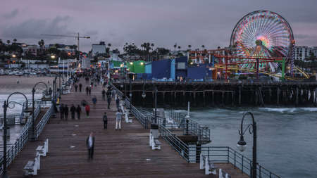 santa monica: Santa Monica, California USA - February 2015.  Amusement park rides and people in motion at The Santa Monica Pier in California