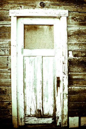 An aged vintage wood door with a worn appearance Stok Fotoğraf