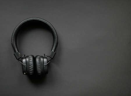 Black headphones on background