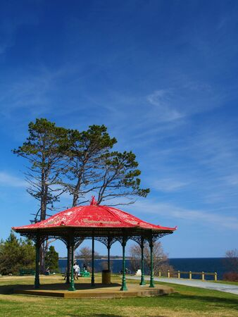 A red gazebo on a bright sunny day. photo