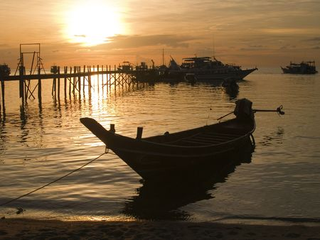 Long Tail Boat at sunset on Koh Tao photo