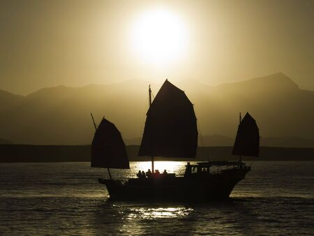 An oriental sunset cruise comming back into port. Banco de Imagens - 2817979