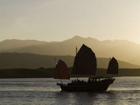 An oriental sunset cruise comming back into port.