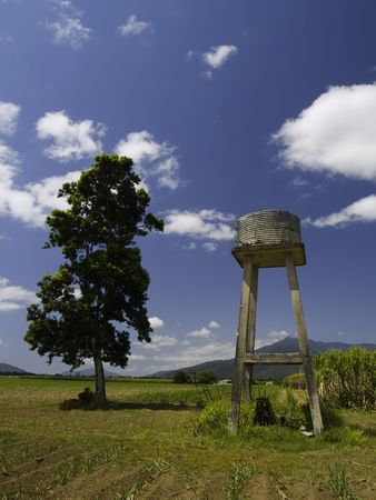 A small water tower on a sugar cane plantation in Australia.