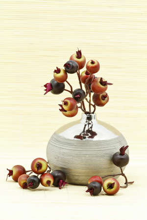 Artificial flower home decoration on bamboo rug photo