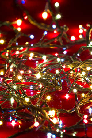 Dimmed Christmas Lights on deep red background photo