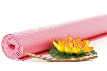 Yoga mat with oriental flower on white background