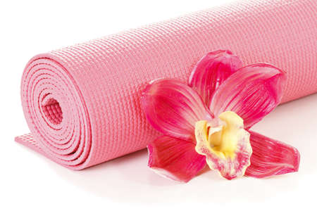 Yoga mat with oriental flower on white background photo