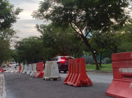 barricades: Road barricades put up for road maintenance while car passing