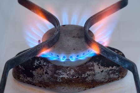broiling: burning gas flame of a gas stove  Stock Photo