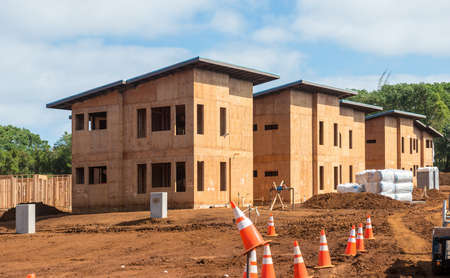 on site: construction site and timber houses Stock Photo