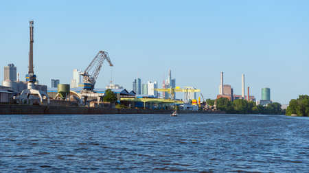 main river: FRANKFURT, HESSEN, GERMANY-JULY 8, 2013: industrial facilities along the main river bank Editorial