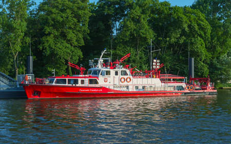 main river: FRANKFURT, HESSEN, GERMANY-JULY 8, 2013: fire fighting boat at the main river bank