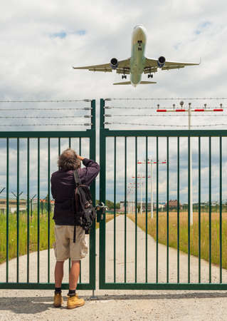 gatherer: KELSTERBACH, HESSEN, GERMANY-JULY 10, 2012: plane spotter at the new airstrip of the rhein main airport frankfurt Editorial