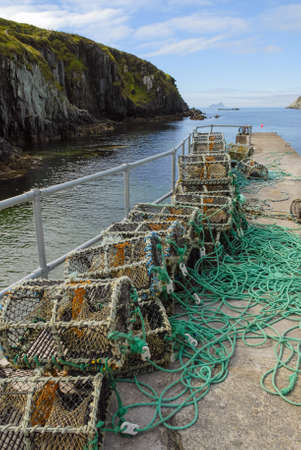 ramp: lobster trap baskets on a boat ramp in ireland