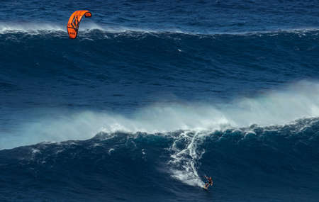 granola: MAUI, HAWAII, USA - DECEMBER 15, 2013: kite surfer is riding a big wave at Jaws