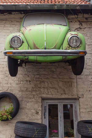 vw: FRANKFURT, HESSEN, GERMANY-OCTOBER 29, 2012: front of a vw beetle at the wall of a garage