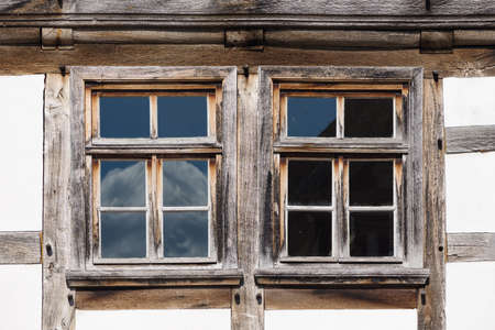 half timbered house: windows of a half timbered house Stock Photo