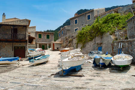 small fishing boats on a boat ramp mallorca Banco de Imagens - 92100996