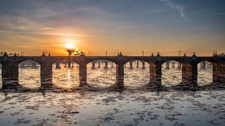 Sunrise over bridges on an ice-filled Susquehanna River in Harrisburg, PA in winter