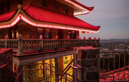 A close-up of the Reading Pagoda featuring the entrance stairs and balcony with roof and foyer lights on Stok Fotoğraf