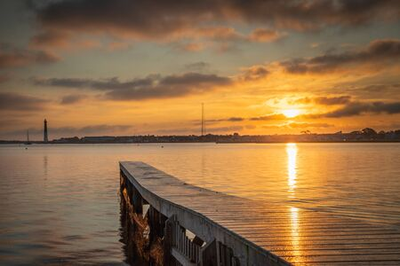 Sunrise landscape from a private dock at High Bar Harbor with Barnegat Lighthouse in the distance 스톡 콘텐츠