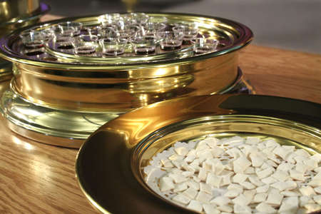 sacrament: Communion Plates with the bread and wine ready to be served.