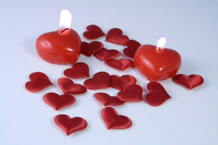 Valentine heart shaped candles with a variety of hearts sprinkled around Stock Photo - 2246481