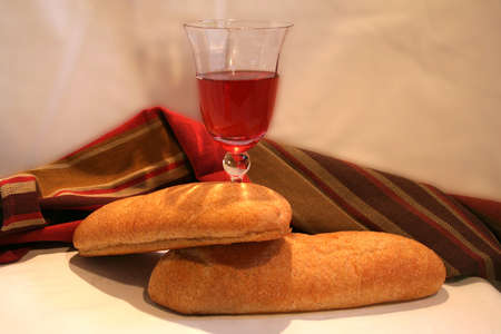 Two Loaves of Bread and a glass of wine