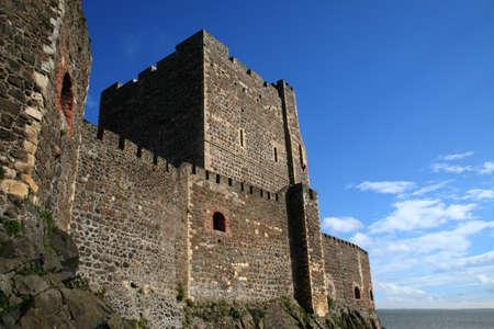 building monumental: The outside of Carrickfergus castle in Northern Ireland looking east