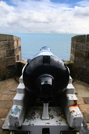 lough: A canon at Carrickfergus castle overlooking the lough