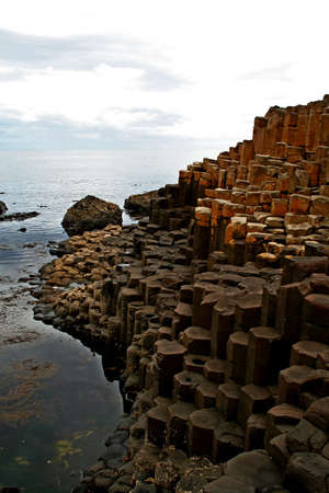 northern ireland: The octagonal rocks at the Giants Causeway on the North Coast of Ireland