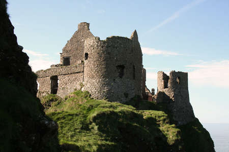 northern ireland: The comforting walls of home Dunluce Castle Northern Ireland Stock Photo