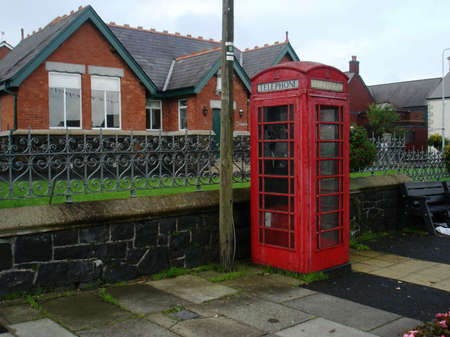 earpiece: A British Phone booth set on a street in a country town Stock Photo