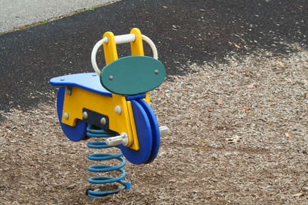 springy: A playground springy motor cycle in the park