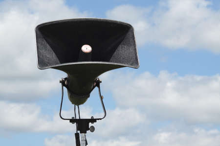 loud speaker: A loud speaker set up in a camp against a blue sky