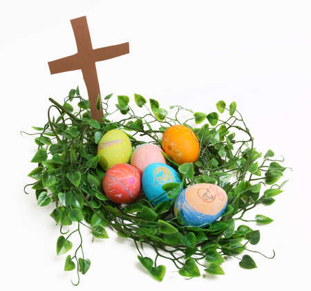 nested: Eggs nested in front of a cross