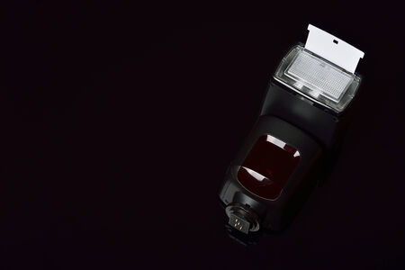 ttl: Camera flash on a black background, focus on reflector Stock Photo