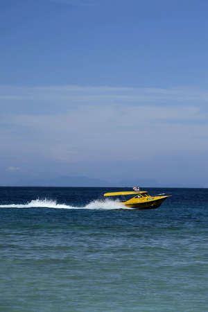 perhentian: A boat navigates across the blue sea at Pulau Perhentian. Stock Photo