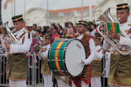A member of military army band wears tiger skins tippet as he performs during a Malaysias national day celebration near Ipoh railway station, Perak state. Editorial