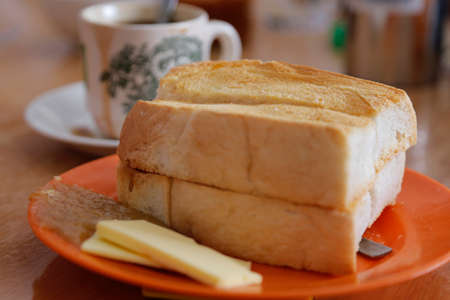 kaya: Roasted bread with frozen butter and Kaya, a speciality breakfast in Kuala Terengganu, Terengganu state.