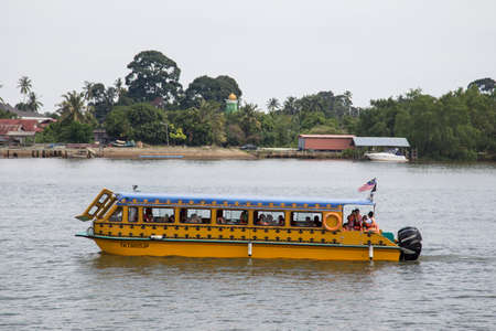 Visitors go sightseeing on a ferry along river during their travel to Kuala Terengganu, Terengganu state.