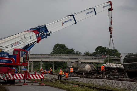 carry out: Crane carry out a damaged wagon from railway after Batu Gajah Train Accident on 28th Oct 2016 in Perak, Malaysia Editorial