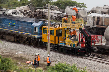 Workers repair high-volt electric line after Batu Gajah Train Accident, the worst train crash of Malaysia on 28th Oct 2016 in Perak, Malaysia
