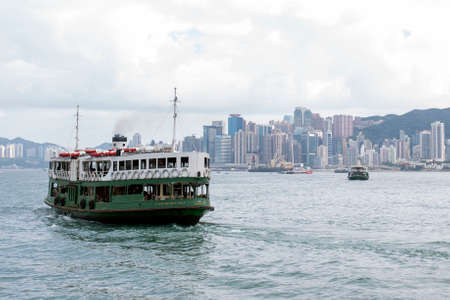Starferry's ferry carries passengers navigates across the strait to Victoria Harbour of Hong Kong Island
