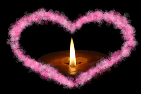 Heart shaped frame with candles on a black background Stock Photo - 858303