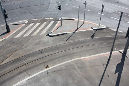 stoplights: Empty city crossroad with track, pavement and road. Traffic sign with stoplights Stock Photo