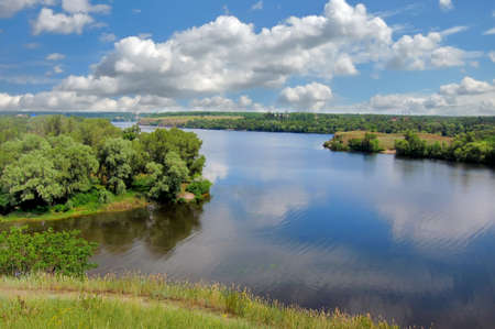dnieper: Summer landscape. Green trees reflected in the Dnieper river near the Zaporizhye city. Stock Photo