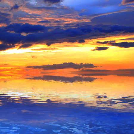 friedrichshafen: Dramatic sky reflection on coastal lagoon at sunset Stock Photo